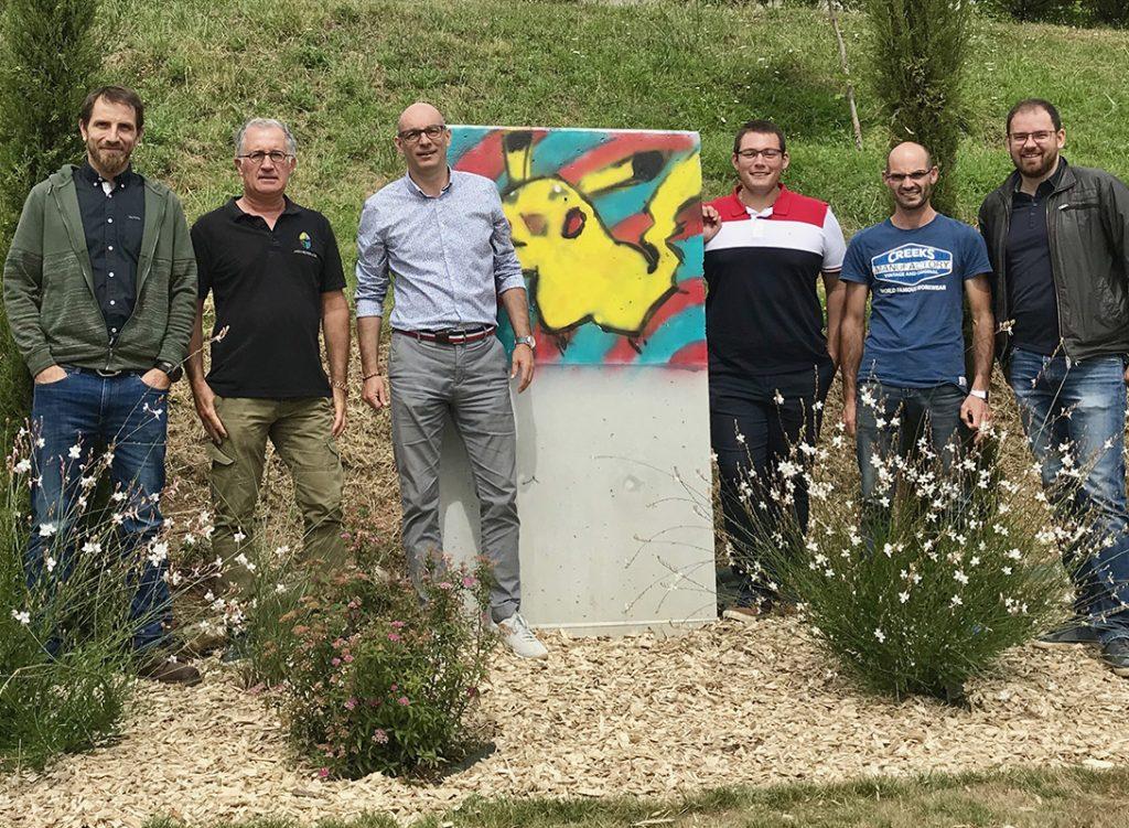 Christophe Planchon d'Expressions jardin avec ses partenaires lors d'une réunion de chantier